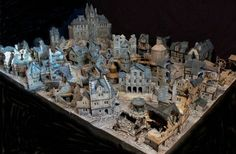 An amazing scratch-built city, for the board game Mordheim. I wish I knew who made this because it's brilliant, and very Peake-ish.