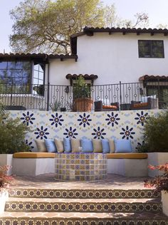 "from Houzz: ""With some architecture styles, like Spanish revival, tiled hardscaping is just so much better than plain cement or stone. It adds instant cheerfulness."" Mediterranean landscape by SoCal Contractor."