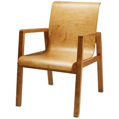 """Chair designed in 1950s by Alvar Aalto.  """"We should work for simple, good, undecorated things, but things which are in harmony with the human being and organically suited to the little man in the street."""" Alvar Aalto, 1957. This chair is undecorated. It just shows natural wood itself. I think this bare wood design is in harmony with the 'human being' as Aalto said."""