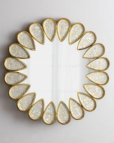 """Petals mirror. Petals inset with thin-cut pieces of abalone shell. Handcrafted of abalone and polished brass. 32""""Dia. x 1""""D. $920 too small?"""