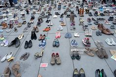 Shoes displayed at place de le Republique which is covered with shoes as part of symbolic rally organized by the NGO Avaaz during the forbidden COP21 demonstration on November 29, 2015 in Paris, France. The demonstration was banned after the Paris terror attacks on Friday, November 13th. Nevertheless, thousands of people gathered to protest against global warming ahead of COP21 and an estimated 100 people were arrested after fighting with police.