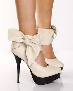 High heels. Black and cream with a bow.