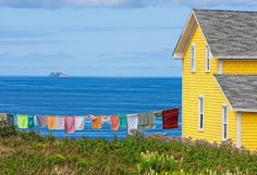 Apparently, this is the coast of France. Looks like Newfoundland Labrador, Canada Quebec, Jig Saw, Yellow Houses, Colorful Houses, Newfoundland And Labrador, Newfoundland Canada, Photos, Pictures, Painting Inspiration