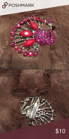 """NWOT Beautiful Peacock Brooch This is a NWOT beautiful peacock brooch in bright pink rhinestones.  This measures approximately 2"""" at the widest point on the brooch.  This has never been worn. Jewelry Brooches"""