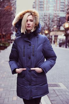 Introducing North Aware's Women's Classic Smart Parka 1.0 Select. The world's first complete winter jacket. A 90/10 duck down  high quality winter coat with faux fur trim and built-in features, like gloves, scarf and hat pocket.