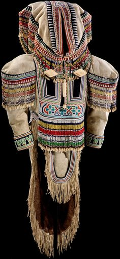 Inuit amauti or tuilli  (woman's parka)  ca. 1890–1925  Iqluligaarjuk (Chesterfield Inlet), Nunavut, Canada  Parka: caribou skin, glass beads, stroud cloth, caribou teeth, and metal pendants; needlecase: ivory, seal hide; carrying strap with toggles: caribou hide, ivory