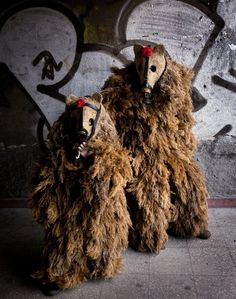 Wearing fearsome masks and imposing costumes these fantastical creatures make a terrifying sight. These costumed men are taking part in the ancient ritual of Kukeri at the Surva International Festival of Masquerade Games in the village of Pernik, Bulgaria. Terrifyingly the men - known as Kukeri - enter houses in the village, clanging their bells to ward off evil spirits. Held at the beginning of February, the tradition has its roots in pre-Roman Bulgaria. Pictured here are a father and son…