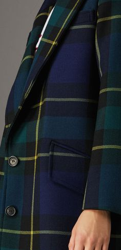 cf6f34200ac A light tailored coat in a statement tartan wool. Wide peaked lapels and  flap pockets