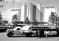 A Greyhound Bus' tram drives in front of Chrysler motors Building at the Chicago World's Fair. (Photographer Unknown/www.bcpix.com)