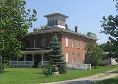 The Erastus Farnham House, just south of Fremont, Indiana only a few miles south of the Michigan border. Built c. 1849, this home was a stop on the Underground Railroad. Its cupola served as a lookout point and a cistern provided water without having to leave the house.