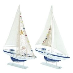 Features:  -Set includes 2 sailing boats.  Product Type: -Model boat/Car/Plane.  Style (Old): -Rustic/Nautical.  Theme: -Sports and recreation.  Subject: -Boats and ships.  Finish: -Blue/White.  Prima