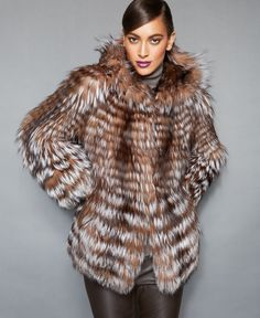 "Plush fox fur gets a fresh, ""feathered"" look from The Fur Vault. The oversized hood makes this luxe jacket even cozier! 