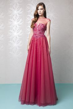 Raspberry A-line Tulle dress embellished with a fully embroidered bust and illusion neckline.