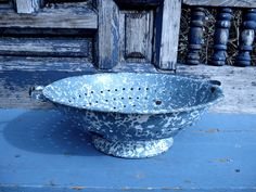 Vintage 1930s rustic blue Graniteware Enamelware colander shabby french country cottage chic farmhouse. $19.50, via Etsy.