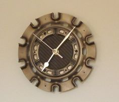 Titanium wall clock made from used F1 racecar parts by LedonGifts