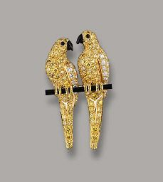 A COLOURED DIAMOND AND ONYX LOVEBIRD BROOCH, BY CARTIER