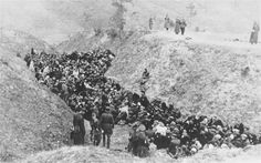 """A large group of Jews awaits execution in a ravine either at Belzec or Sobibor death camps, 1941. At this early stage, extermination was still being carried out mainly with firearms. German """"experts"""" though decided that this was """"unsophisticated"""" and expensive, given the amounts of ammunition used. Soon, gas chambers and crematoria would take over as steps toward """"efficiency."""" It's crazy how sad this makes me."""