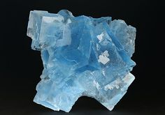 Aesthetic lustrous gemmy blue intergrown cubic crystals measuring to 4cm from Le Burg Mine, France.