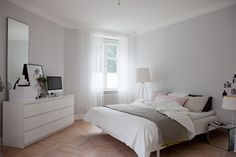 Calm grey and white room in a Swedish home in a former shop. Bolaget.