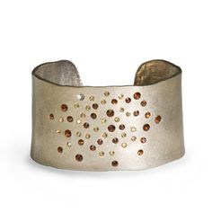 """The Sienna Cuff features a gold cuff adorned with a bounty of amber crystals. This bracelet will be the perfect accompanyment for this season's citrus clothing. 1.5"""" in width (SIENNA GOLD CUFF) www.michell.kitsylane.com $28.00"""
