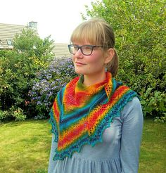 A versatile shape which can be worn as a shoulder shawl or bunched up as a scarf. The stitch pattern showcases the beautiful rainbow yarn. Iona can be worn as a shrug with the addition of two buttons.