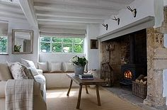 Another inset wood stove. Thermal mass surround and increased safety. Cottage Lounge, Cottage Inspiration, Cottage Living Rooms, Home Living Room, Cotswolds Cottage, Cottage Interiors, Home, Cottage Living, Inglenook Fireplace