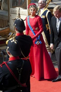 Máxima wears a red Valentino gown. Click on the image to see more looks.