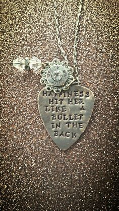 Florence and the machine inspired. Dog Days Are Over. Handstamped guitar pick necklace with real bullet charm. Your choice of a short of long