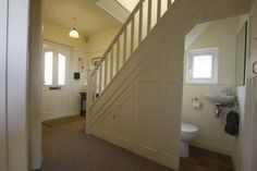 content in a cottage   room under stairs, powder room