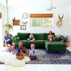 @jodimockabee's energetic brood of five is no match for the #SvenSectional's ample room and gorgeous green velvet.