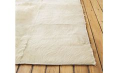 Patch Cowhide Rug to soften your step #DWRdining