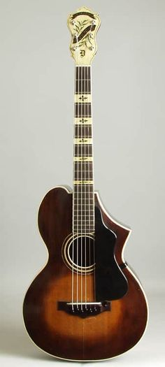 Epiphone Recording Syle D Model Arch Top Acoustic Guitar, c. 1930, made in New York City, serial # 285, sunburst lacquer finish, maple back and sides, spruce top; laminated maple neck with ebony fingerboard, original black hard shell case. Epiphone's Recording model guitars-offered for sale bri...