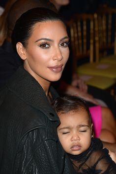 Kim Kardashian and baby North West attend the Givenchy show as part of the Paris Fashion Week Womenswear Spring/Summer 2015 on September 2014 in Paris, France. Kim Kardashian And North, Kim And Kanye, Kardashian Family, Kardashian Style, Kardashian Jenner, Kris Jenner, Kanye West Family, Kim And North, Bae