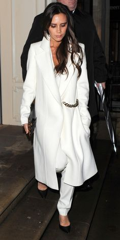 Victoria Beckham elegantly wears her winter whites: white coat & white trousers.
