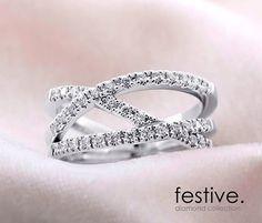 Festive Diamond Collectio - Maxine timanttisormus. 34 x 0,01 W/SI 1 timantit. Leveys 8 mm. Design Marko Osala. Suositushinta 2090 e.  www.festive.fi/