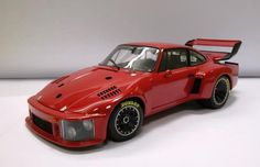 1976 Porsche 935 Turbo Prototype, 1/18 Scale Diecast by Exoto (Retired).  A successor to the 930 Turbo, it used the Porsche body shape inspired by the production 911s. The front fenders were cut down for the headlights creating the Slant Nose. It was built to comply with the 1976 Group 5 rules, & was powered by a 2,856 cc six cylinder 'flat' engine with a single turbocharger & a water-cooled intercooler as the preferred air/air type, was prohibited by the CSI. It produced 590 b hp at 7,900…