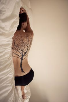 High Class Couture tree tattoo on back