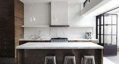 I love the mix of white and wood kitchen