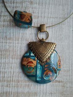 Gorgeous PC pieces by   Arliane     mixed media with metal findings and polymer clay