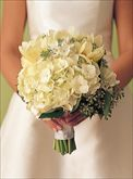 ranunculus, roses, narcissus, hydrangeas, ornamental kale, china berries, lady's mantle