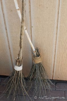 Make your own witch brooms to prop up in the corner under the floating hat.