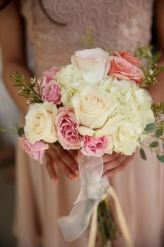rose bouquet, photo by Pepper Nix Photography http://ruffledblog.com/backyard-chic-utah-wedding #flowers #roses #bouquets
