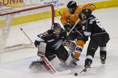 Goalie Danny Battochio stops the puck as D-man Riley Weselowski tries to give him some viewing room