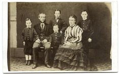 Vintage carte de visite of a family, including four boys, taken in a studio by S. Bardsley, Manchester (printed on reverse). Probably 1860s. Interesting costume.