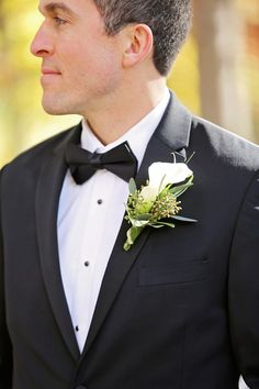 Formal groom outfit idea - classic black tux with calla lily boutonniere {Kelli Carrico Photography}