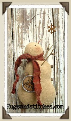 Catching Snowflakes made from grunged flannel with a homespun scarf and stick arms.