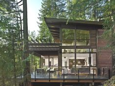 Home Design. Awesome Industrial Style Wood House With Black Metal Frame With Chic Glass House With Two Floor High Glass Wall And Windows And Modern Rustic Exterior Forest House With Clean Looking White Interior Design. Adorable Northwest Modern Homes – Designs And Architectures