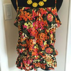 HOST PICK  Urban outfitters floral tank Super cute lightweight floral tank from kimchi blue with ruffles and tiny peplum skirt.  In excellent condition. Pair with jeans or shorts for spring and summertime. Size M. Urban Outfitters Tops Tank Tops