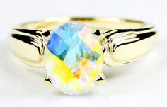 R058, Mercury Mist Topaz, 10Ky Gold Ring * Stone Type - Mercury Mist Topaz * Approximate Stone Size - 9x7mmmm  * Approximate Stone Weight - 2.3 cts  * Jewelry Metal - Solid 10k Yellow Gold * Approximate Metal Weight - 2.6 grams  * Ring Size - Size selectable during checkout * Our Warranty - A full year on workmanship  * Our Guarantee - Totally unconditional 30 day guarantee