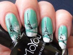 I started out with a basecolor,Essence Color & Go - 79 Viva la Green.  Then I applied striping tape to mynailsand sponged the tips with white  polish.I removed the striping tape andstampedthe Eiffel Tower andpart  of theAmericanflagg from MoYou N16.